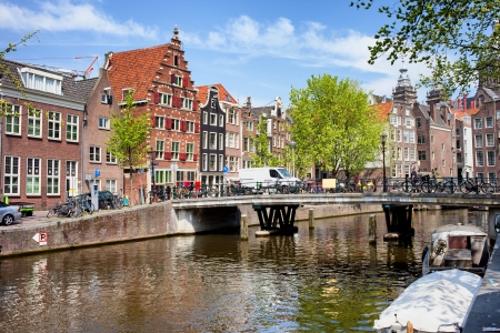sights: Bridge and traditional Dutch houses on Oudezijds Voorburgwal canal, city of Amsterdam, Netherlands. Stock Photo