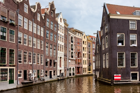 Amsterdam canal houses, traditional, historic, residential architecture in the capital city of the Netherlands. photo