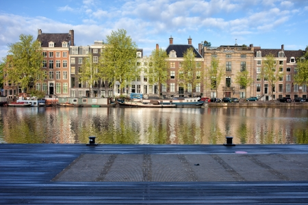 amstel river: Amstel river waterfront in the city of Amsterdam, Netherlands, North Holland province.