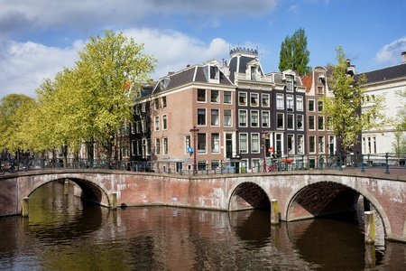 Traditional Dutch style canal houses in Amsterdam, Netherlands. photo