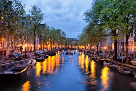 Tranquil evening by the canal in the city of Amsterdam, Netherlands, North Holland. Stock Photo