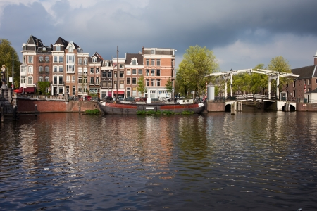 amstel river: Amsterdam skyline, houses by the Amstel river and bridge on Nieuwe Herengracht, Netherlands, North Holland.