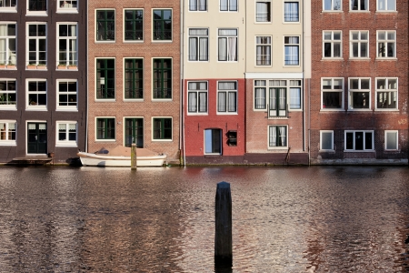 Traditional Dutch style historical row houses on a cana in Amsterdam, Holland, Netherlands. photo