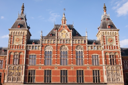 neo gothic: Amsterdam Central Train Station facade in Holland, Netherlands, 19th century Neo-Renaissance and Neo-Gothic style.