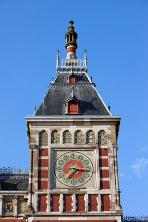 neo gothic: Clock tower of the Central Train Station in Amsterdam, Holland, Netherlands.