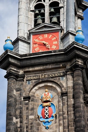 westerkerk: Amsterdam coat of arms, clock and bells of Westerkerk (Western Church) bell tower, Holland, Netherlands.