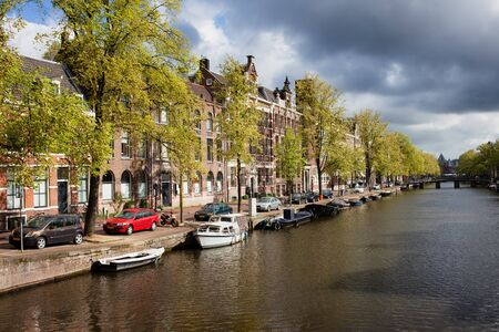north holland: Springtime by the Kloveniersburgwal canal in the city of Amsterdam, Netherlands, North Holland province. Stock Photo