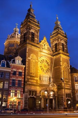 st nicholas: Saint Nicholas Church (Dutch: Sint Nicolaaskerk) illuminated at night in Amsterdam, Holland, Netherlands.