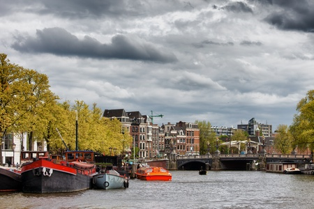 amstel river: City of Amsterdam cityscape by the Amstel river in Netherlands, North Holland province.