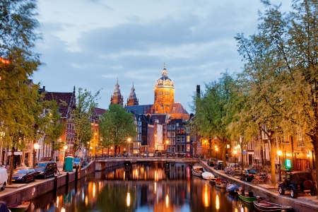 amsterdam canal: Red Light District in Amsterdam at dusk in Netherlands, North Holland province.