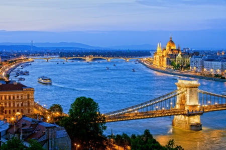 Budapest cityscape in the evening with illuminated Chain Bridge and Margaret Bridge over Danube river and Hungarian Parliament Building.