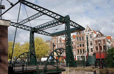 drawbridge: Drawbridge and historic row houses in Amsterdam, Netherlands. Stock Photo