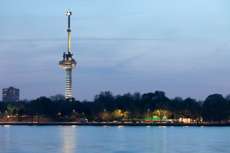euromast: Euromast tower at twilight in Rotterdam, Netherlands, river view.