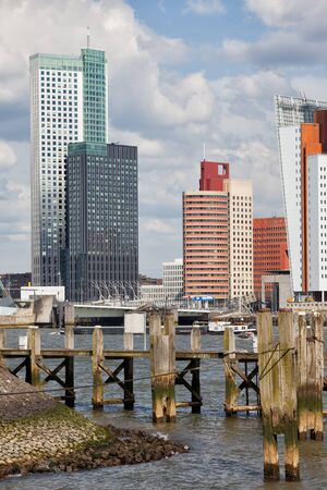 maas: City of Rotterdam downtown skyline and wooden pier on Nieuwe Maas (New Meuse) river in Netherlands, South Holland province.