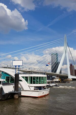 maas: City downtown of Rotterdam, Nieuwe Maas river and Erasmus Bridge in Netherlands, South Holland province. Stock Photo