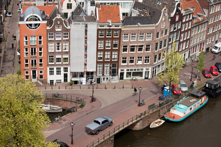 prinsengracht: City of Amsterdam, historic row houses from above, corner of Bloemgracht and Prinsengracht streets, Holland, Netherlands.