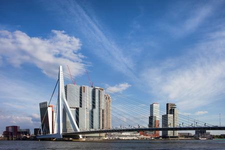 rotterdam: City of Rotterdam downtown skyline and Erasmus Bridge on Nieuwe Maas (New Meuse) river in Netherlands.