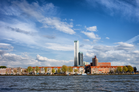 maas: Terraced houses skyline along New Meuse (Dutch: Nieuwe Maas) river in Rotterdam city centre, Netherlands.