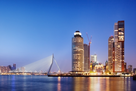 rotterdam: City of Rotterdam downtown skyline at dusk in South Holland, Netherlands, Erasmus Bridge on the left.