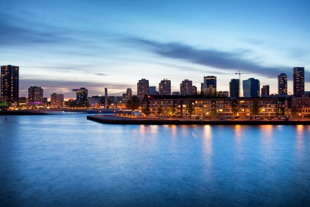 maas: Tranquil river view of the Rotterdam city centre in Holland, Netherlands at dusk.