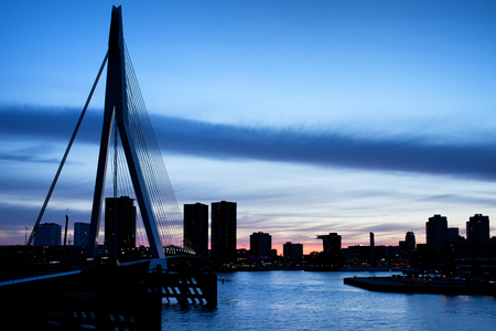 rotterdam: City of Rotterdam skyline silhouette at dusk in the Netherlands, South Holland province.