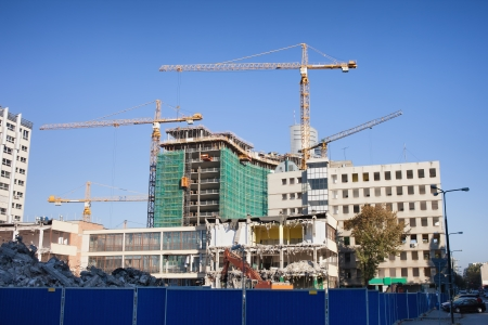 disassembly: Cranes, office and apartments buildings on construction and deconstruction sites in Warsaw, Poland.