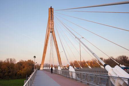 bicycle lane: Modern architecture of the Swietokrzyski cable-stayed bridge in Warsaw, Poland. Stock Photo