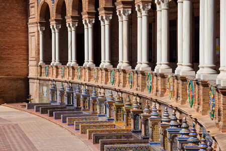 architectural heritage: Colonnade and tiled benches of the Plaza de Espana pavilion in Seville, Andalusia, Spain. Stock Photo