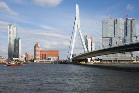 rotterdam: Downtown skyline of Rotterdam, Erasmus Bridge (Erasmusbrug) in South Holland, Netherlands. Stock Photo