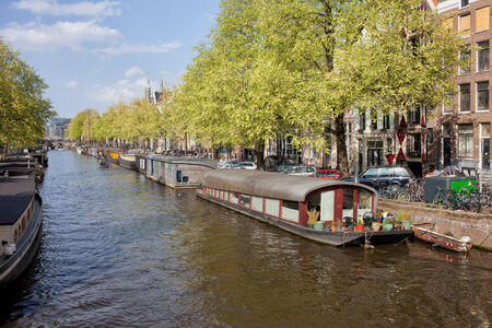 Houseboats on a canal in Amsterdam, the Netherlands. photo
