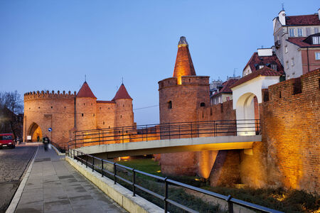 fortified wall: Fortifications of the Old Town in Warsaw, Poland at dusk, barbican, tower and fortified wall. Editorial