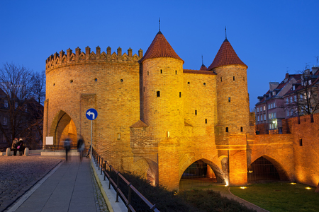 Barbican fortification of the Old Town, illuminated at night in Warsaw, Poland.