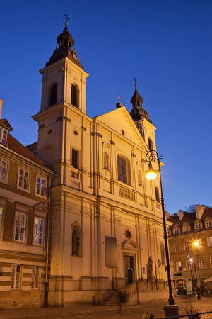 17th: Baroque style 17th century Church of the Holy Spirit at night in the New Town, Warsaw, Poland.