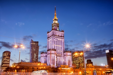 Palace of Culture and Science (Polish: Palac Kultury i Nauki) at dusk, Warsaw city downtown, Poland.