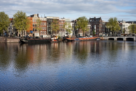 amstel river: City of Amsterdam cityscape, terraced houses along Amstel river in Holland, the Netherlands. Stock Photo