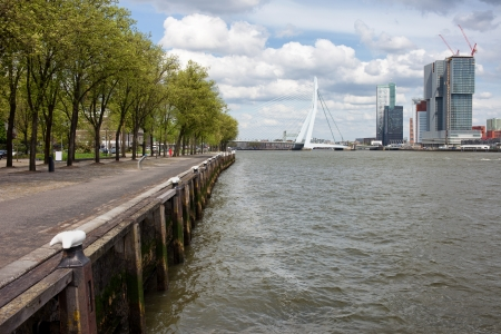 rotterdam: River embankment in the city centre of Rotterdam, Erasmus Bridge at the far end, South Holland, the Netherlands. Stock Photo