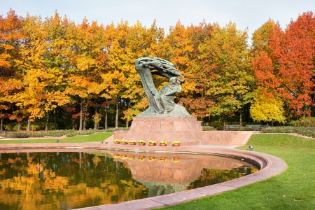 chopin heritage: Fryderyk Chopin monument in autumn scenery of the Royal Lazienki Park in Warsaw, Poland, designed around 1904 by Waclaw Szymanowski (1859-1930).