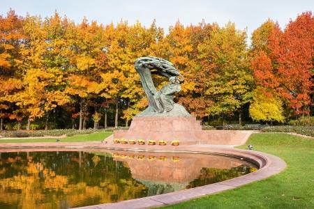 lazienki: Fryderyk Chopin monument in autumn scenery of the Royal Lazienki Park in Warsaw, Poland, designed around 1904 by Waclaw Szymanowski (1859-1930).