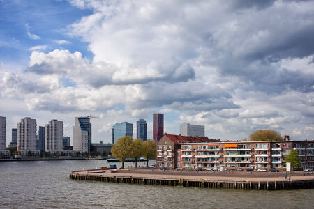 maas: City of Rotterdam cityscape with apartment houses on a river island in South Holland, the Netherlands. Stock Photo