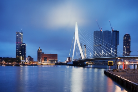 netherland: City of Rotterdam downtown skyline by the river at night in South Holland, the Netherlands.