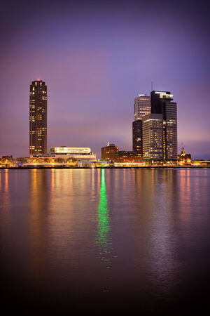 holand: River view of Rotterdam city centre at night in South Holand, the Netherlands.
