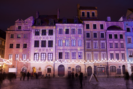 tenement: Terraced tenement houses at night in the Old Town of Warsaw, Poland, Christmas illumination.