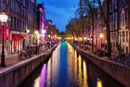 Amsterdam Red Light District by night in the old part of the city, North Holland, the Netherlands. photo