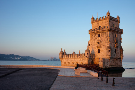 torre: Belem Tower and promenade along the Tagus river at sunrise in Lisbon, Portugal. Stock Photo