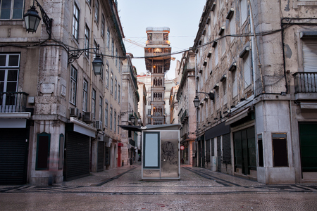 Santa Justa Lift (Portuguese: Elevador de Santa Justa) in Lisbon, Portugal and an old apartment houses in Baixa part of the city. photo