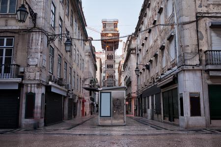 elevador: Santa Justa Lift (Portuguese: Elevador de Santa Justa) in Lisbon, Portugal and an old apartment houses in Baixa part of the city. Stock Photo