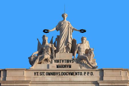 valor: Statues at the top of Rua Augusta Arch in Lisbon, Portugal. Allegory of Glory rewarding Valor and Genius. Stock Photo