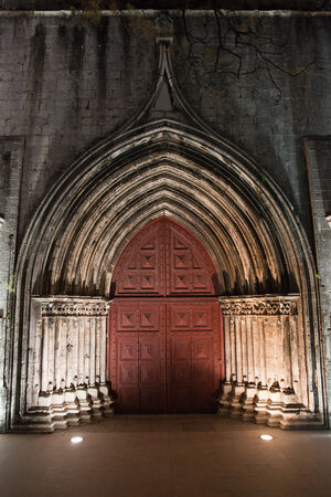 carmo: Gothic portal to the Carmo Church and Convent illuminated at night in Lisbon, Portugal. Stock Photo
