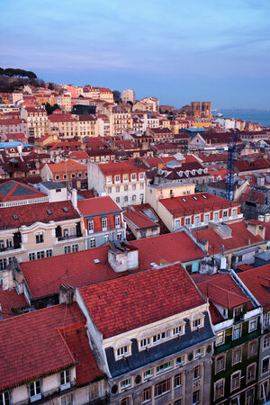baixa: City of Lisbon at twilight in Portugal, rooftops of the Baixa and Alfama districts.