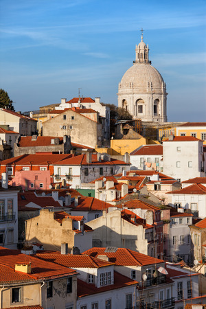 City of Lisbon in Portugal, picturesque old houses in the Alfama District, sunset time. photo